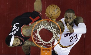Cleveland Cavaliers' LeBron James (23) shoots against Toronto Raptors' James Johnson (3) during the first half of Game 5 of the NBA basketball Eastern Conference finals Wednesday, May 25, 2016, in Cleveland. (AP Photo/Tony Dejak)