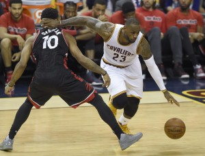 Cleveland Cavaliers' LeBron James (23) fouls Toronto Raptors' DeMar DeRozan (10) during the second half of Game 1 of the NBA basketball Eastern Conference finals Tuesday, May 17, 2016, in Cleveland. (Frank Gunn/The Canadian Press via AP)