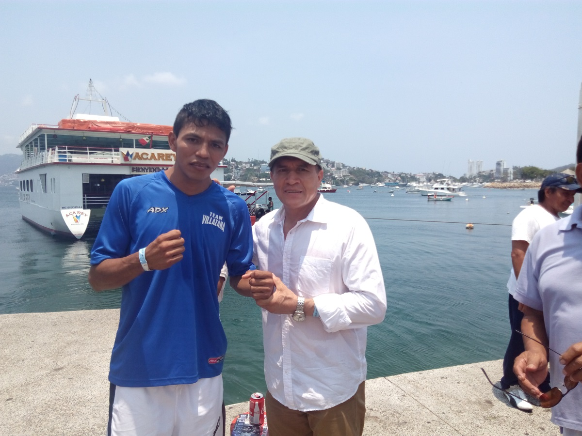 Villasana jr., junto a su entrenador. Foto: Osiris Méndez
