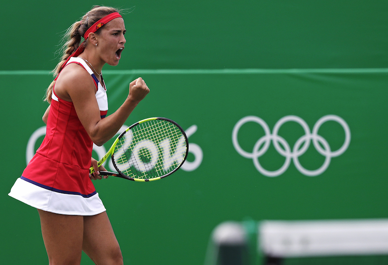 Monica Puig, of Puerto Rico, pumps her fist after winning a point against Laura Siegemund, of Germany, at the 2016 Summer Olympics in Rio de Janeiro, Brazil, Thursday, Aug. 11, 2016. (AP Photo/Charles Krupa)