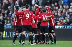 Manchester United's Paul Pogba, third from right, celebrates with his team-mates after scoring his side's first goal during the Premier League soccer match between Swansea City and Manchester United at the Liberty Stadium, Swansea, Wales. Sunday Nov 6, 2016. (Nick Potts/PA via AP)