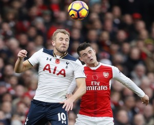 Tottenham's Harry Kane, left, jumps for the ball with Arsenal's Granit Xhaka during the English Premier League soccer match between Arsenal and Tottenham Hotspur at Emirates stadium in London, Sunday, Nov. 6, 2016. (AP Photo/Kirsty Wigglesworth)