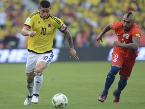 Colombia's James Rodriguez, left, and Chile's Arturo Vidal chase the ball in a 2018 World Cup qualifying soccer match in Barranquilla, Colombia, Thursday, Nov. 10, 2016. (AP Photo/Luis Benavides)