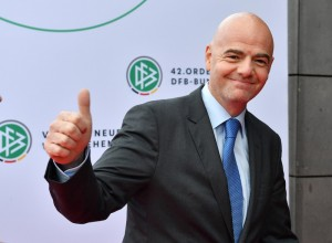 FIFA president Gianni Infantino arrives at a meeting of delegates of the German Football Federation, DFB, in Erfurt, eastern Germany, Thursday Nov.3, 2016. ( Martin Schutt/dpa via AP)