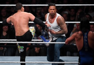 In this Nov. 3, 2016 photo former soccer player Tim Wiese aka. 'The Machine', center, performs at the Wrestling event at the Olympiahalle in Munich, Germany. , at his wrestling debut during and event of World Wrestling Entertainment (WWE) in Munich. (Sven Hoppe/dpa via AP)