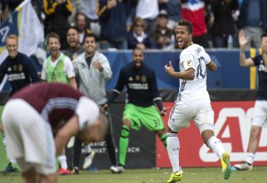 Los Angeles Galaxy's Giovani dos Santos celebrates his goal against the Colorado Rapids in the second half of a first leg soccer match of the Western Conference Semifinals of the MLS Cup Playoffs in Carson, Calif., Sunday, Oct. 30, 2016. (Kyusung Gong/Orange County Register via AP)