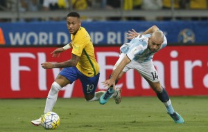 In this Nov. 10, 2016 photo, Brazil's Neymar dibbles past Argentina's Javier Mascherano during a 2018 World Cup qualifying soccer match at the Estadio Mineirao in Belo Horizonte, Brazil. Brazil won the match 3-0. (AP Photo/Leo Correa)