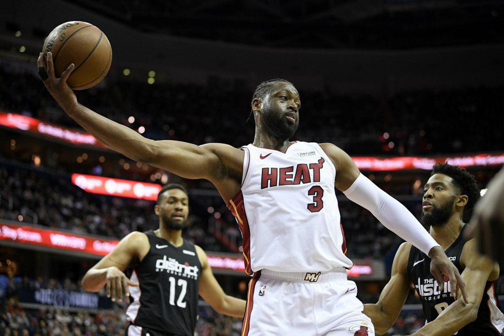 Wade anota 20 puntos y Heag gana 113-108 a Wizards