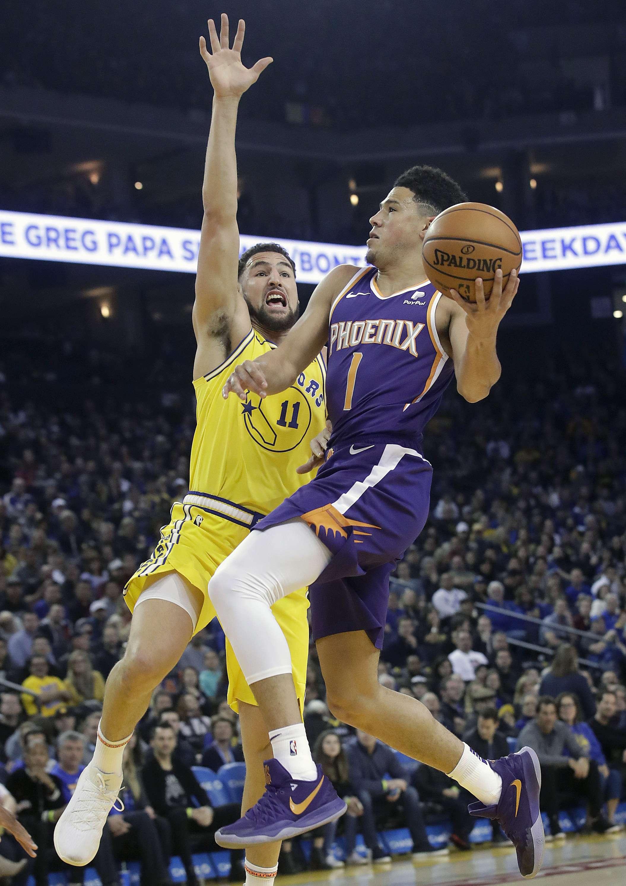 Booker y los Suns rompen racha de 19 derrotas ante Warriors
